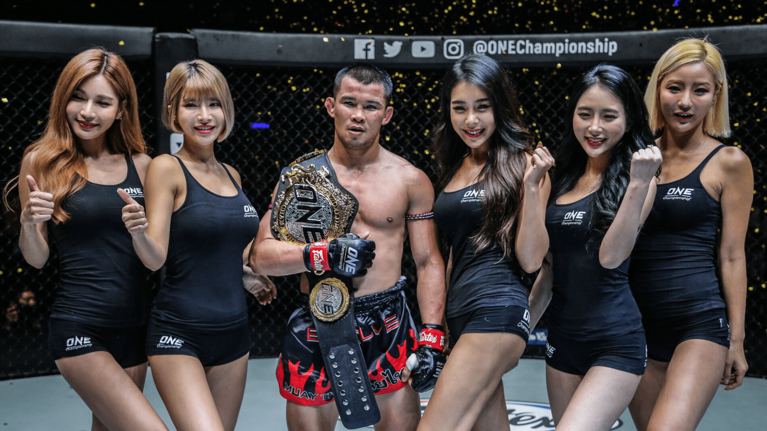 Nong-O And Petchdam Walk Away From The Impact Arena With The Belts
