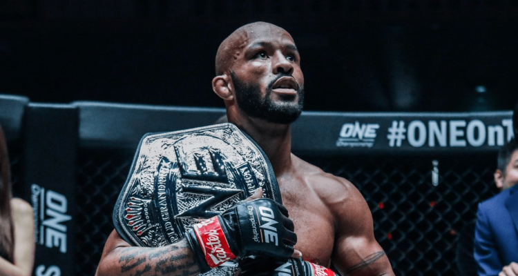 Demetrious Johnson with ONE Championship Flyweight Grand Prix belt